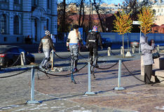 Three girls go on stilts on the Petrograd embankment, Saint-Petersburg Stock Photo