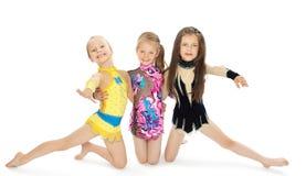 Three girls gymnasts Stock Photos