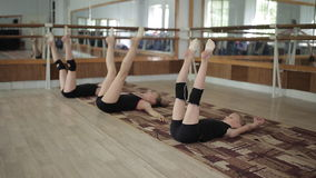 Three girls gymnasts perform exercises in the gym stock video