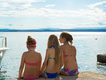 Three girls having rest on a beach Stock Image