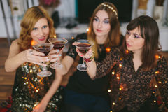 Three girls having a toast for New Year`s Eve, focus on the glas Stock Image