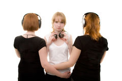 Three girls in headphones Royalty Free Stock Photography