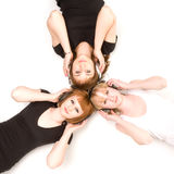 Three girls in headphones Stock Images