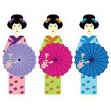 Three girls in japanese dress Stock Photography