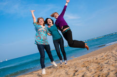 Three girls jump. At the beach Stock Photography