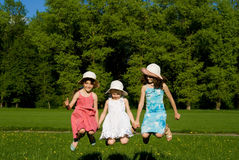 Three girls jumping Stock Photos
