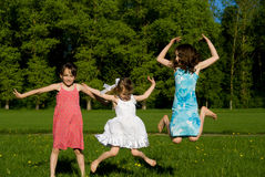 Three girls jumping Stock Photo