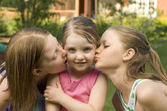 Three girls kissing Royalty Free Stock Photo