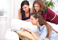 Three girls and a laptop Royalty Free Stock Images