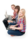 Three girls with laptops Stock Photo