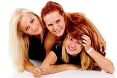 The three girls lie on the floor Royalty Free Stock Images