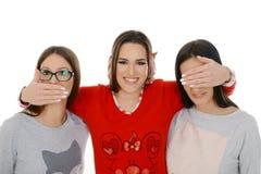 Three girls like three monkeys royalty free stock photos