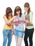 Three girls look magazine. Three young woman look fashion magazine over white Stock Photography