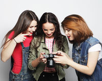 three girls looking at camera Stock Images