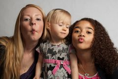Three girls making faces Royalty Free Stock Photos