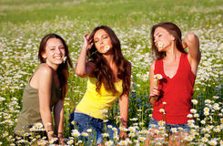 Three girls on the meadow Stock Photo