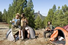 Three girls in mountain landscape in camping Royalty Free Stock Images