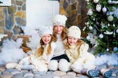 Three girls near a Christmas Stock Photo