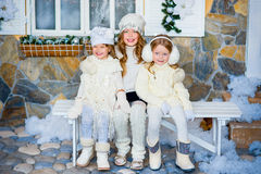 Three girls near a Christmas Royalty Free Stock Photo
