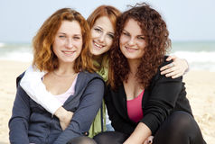 Three girls at outdoor near beach. Stock Photo