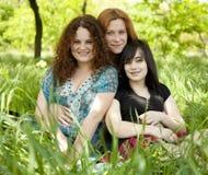 Three girls at park. Royalty Free Stock Image