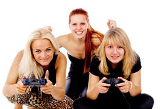 The three girls play video games Stock Photo