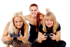 The three girls play video games Stock Photo