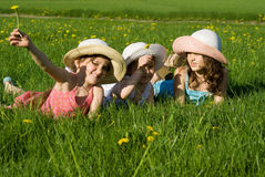Three girls are playing in the grass Stock Images