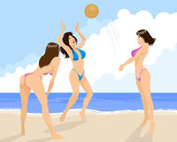 Three girls playing volleyball Stock Photos