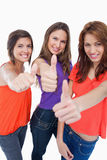 Three girls proudly showing their happiness Stock Photos