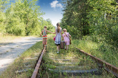 Three girls on the railway Royalty Free Stock Images