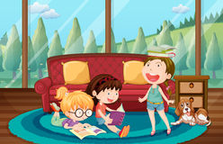 Three girls reading book in the living room Stock Images
