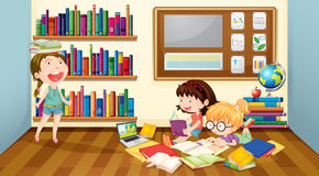 Three girls reading books in room Stock Photo
