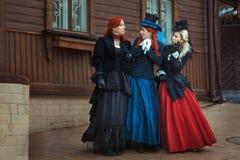 Three girls in retro dresses. royalty free stock image