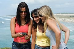 Three beautiful women taking selfie on the beach Stock Images