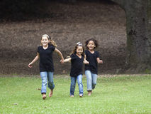 Three girls running Royalty Free Stock Images
