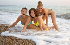 Three girls at the sea Royalty Free Stock Image