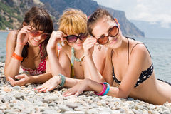 Three girls on seashore Stock Photo