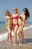 Three girls on seashore Royalty Free Stock Photo