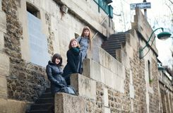 Three girls on the Seine embankment Stock Photos