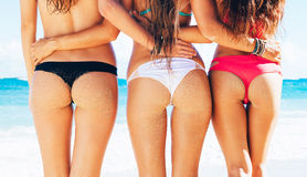 Three Girls in Sexy Bikinis on the Beach Royalty Free Stock Photos