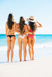 Three Girls in Sexy Bikinis on the Beach Royalty Free Stock Image