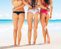 Three Girls in Sexy Bikinis on the Beach Stock Image