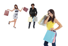 Three girls shopping. On a over white background Royalty Free Stock Photo