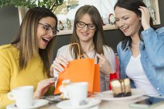 Three girls after shopping stock image