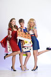 Three girls  after shopping Stock Photography