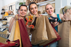 Three girls shopping together stock photo