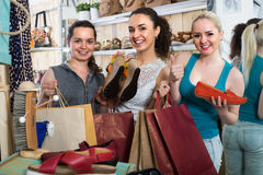 Three girls shopping together royalty free stock images