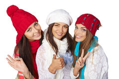 Three girls showing approving gestures Royalty Free Stock Photography