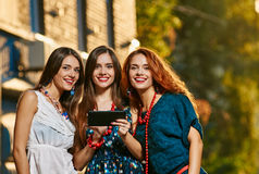 Three girls sisters toursits Royalty Free Stock Image